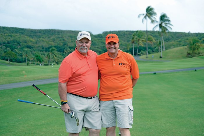 Graves and his golf partner Gary Lawson from Ditch Witch