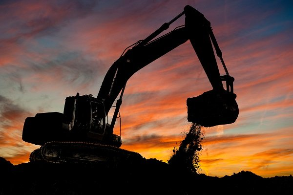 excavator in sunset