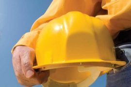 Construction worker holding hat