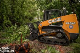 Clearing brush with a Case track loader