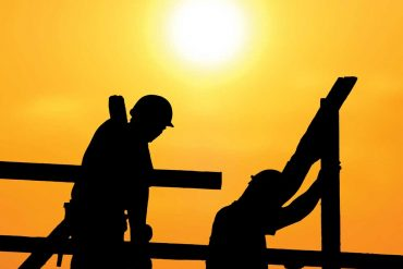 construction workers in the sun