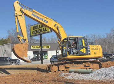 MGL Inc. Supervisor Joe Collins uses a Komatsu PC210LC