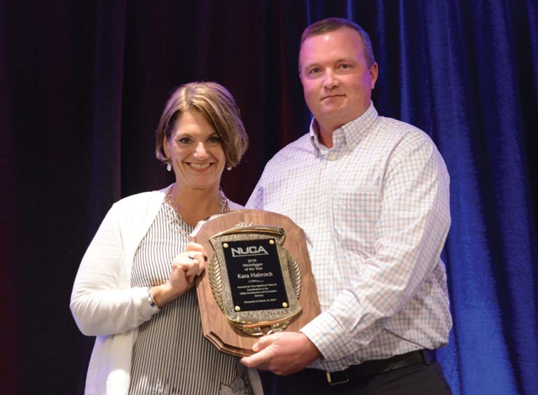 Kara Habrock accepts the 2019 Ditchdigger of the Year award