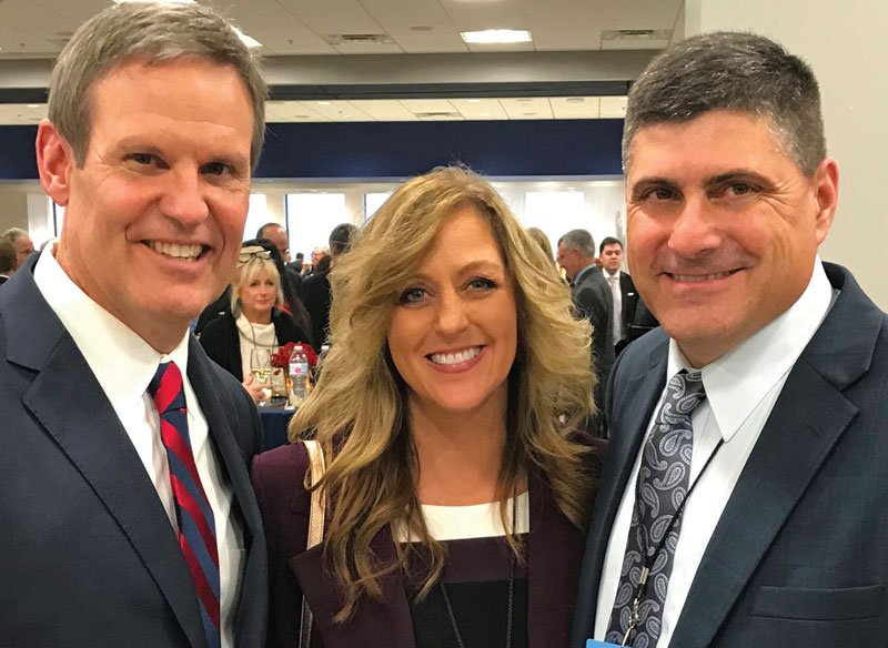 Tennessee Governor Bill Lee (left) congratulates Dawn and Darren Cleary