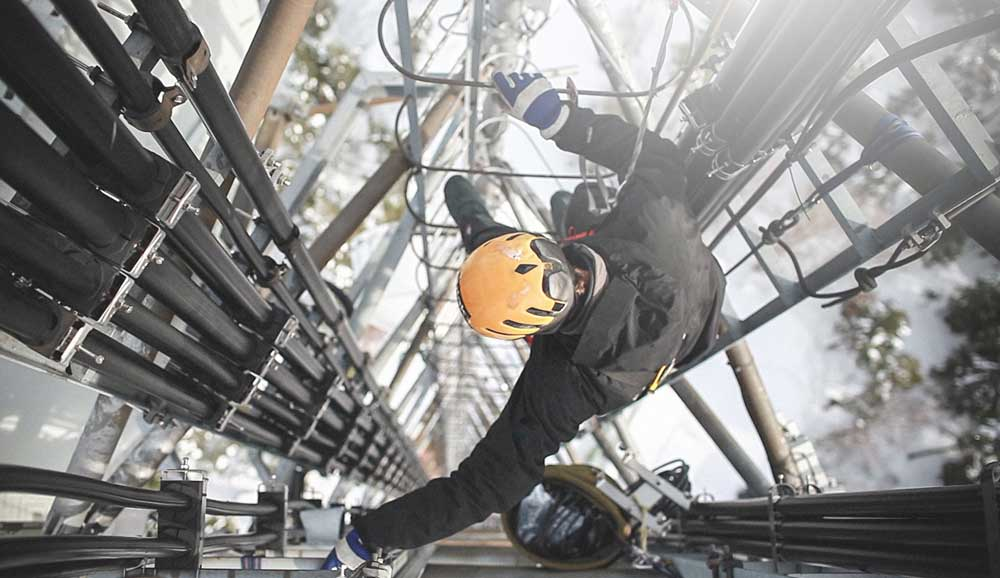 man working on a utility tower